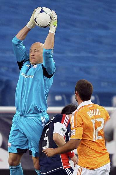 FOXBORO, MA - MAY 19:  Matt Reis #1 of the New England Revolution makes a stop as Will Bruin #12 of