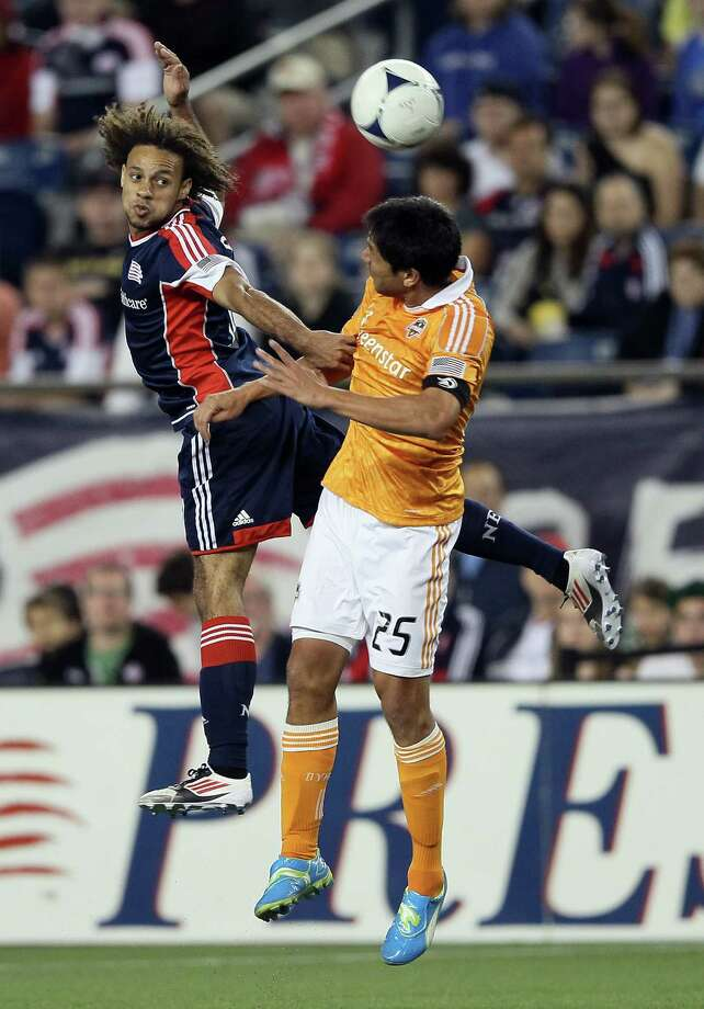 FOXBORO, MA - MAY 19:  Kevin Alston #30 of the New England Revolution and Brian Ching #25 of the Houston Dynamo fight for the ball on May 19, 2012 at Gillette Stadium in Foxboro, Massachusetts.The New England Revolution and the Houston Dynamo tied 2-2. Photo: Elsa, Getty Images / 2012 Getty Images