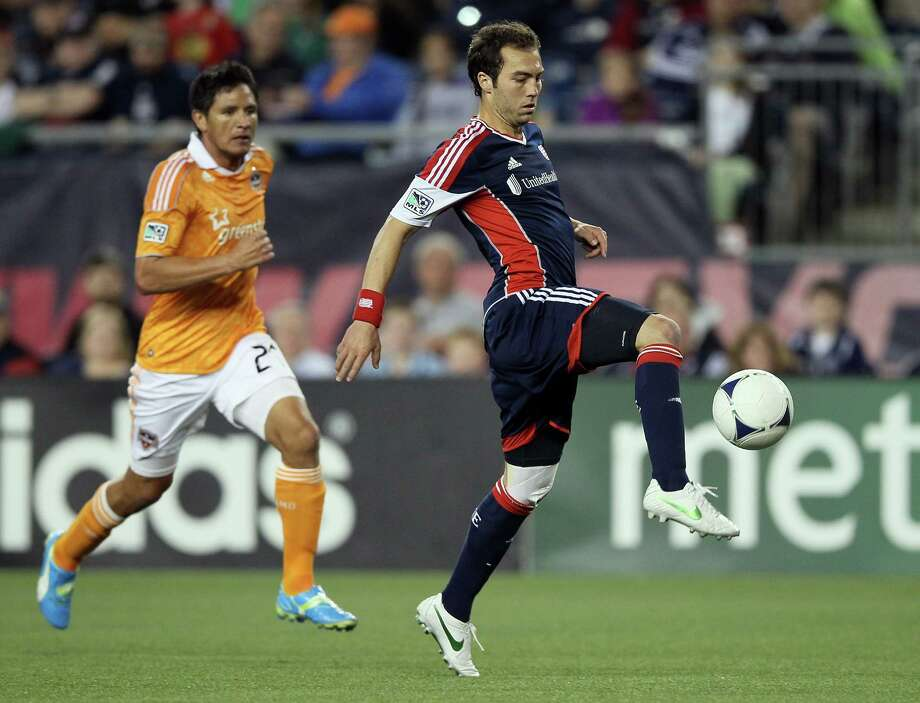 FOXBORO, MA - MAY 19:  A.J. Soares #5 of the New England Revolution takes the ball as Brian Ching #25 of the Houston Dynamo defends on May 19, 2012 at Gillette Stadium in Foxboro, Massachusetts.The New England Revolution and the Houston Dynamo tied 2-2. Photo: Elsa, Getty Images / 2012 Getty Images