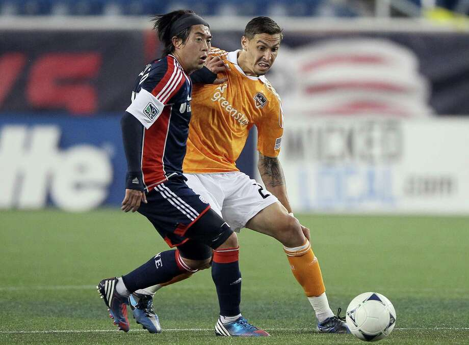 FOXBORO, MA - MAY 19:  Geoff Cameron #20 of the Houston Dynamo and Lee Nguyen #24 of the New England Revolution fight for the ball on May 19, 2012 at Gillette Stadium in Foxboro, Massachusetts.The New England Revolution and the Houston Dynamo tied 2-2. Photo: Elsa, Getty Images / 2012 Getty Images