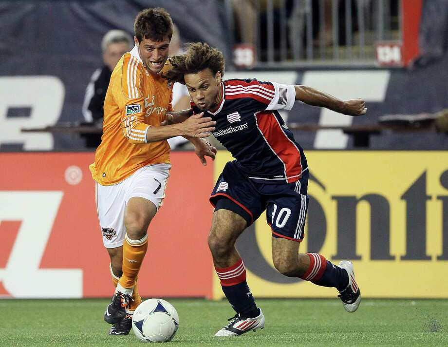 FOXBORO, MA - MAY 19:  Colin Clark #7 of the Houston Dynamo and Kevin Alston #30 of the New England Revolution fight for the ball on May 19, 2012 at Gillette Stadium in Foxboro, Massachusetts.The New England Revolution and the Houston Dynamo tied 2-2. Photo: Elsa, Getty Images / 2012 Getty Images