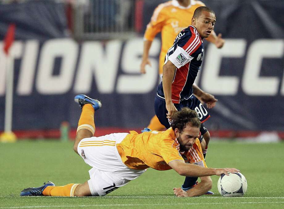 FOXBORO, MA - MAY 19:  Adam Moffat #16 of the Houston Dynamo tries to keep the ball from Fernando Cardenas #80 of the New England Revolution on May 19, 2012 at Gillette Stadium in Foxboro, Massachusetts.The New England Revolution and the Houston Dynamo tied 2-2. Photo: Elsa, Getty Images / 2012 Getty Images