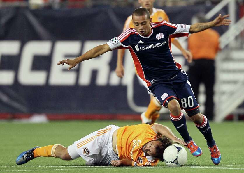 FOXBORO, MA - MAY 19:  Adam Moffat #16 of the Houston Dynamo tries to keep the ball from Fernando Ca