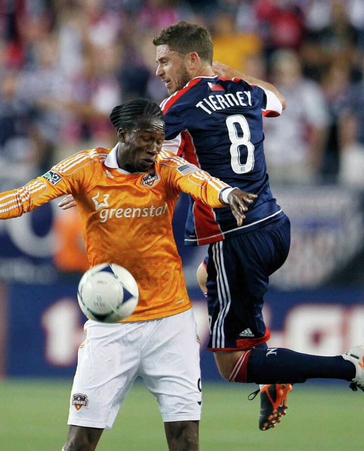 Houston Dynamo's Macoumba Kandji, left, and New England Revolution's Chris Tierney (8) vie for the ball in the second half of an MLS soccer game in Foxborough, Mass., Saturday, May 19, 2012. The game ended in a 2-2 tie. (AP Photo/Michael Dwyer) Photo: Michael Dwyer, Associated Press / AP