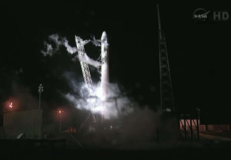 This framegrab from NASA-TV shows the Falcon 9 SpaceX rocket on the launch pad at complex 40 at the Cape Canaveral Air Force Station in Cape Canaveral, Fla., seconds after the launch was aborted due to technical problems early Saturday May 19, 2012. The launch is rescheduled for Tuesday morning May 22, 2012 at 3:44 a.m. EDT Photo: AP
