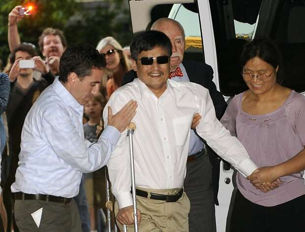 Blind Chinese legal activist Chen Guangcheng arrives at Washington Square Village on the campus of New York University, Saturday, May 19, 2012, in New York.  Chen escaped from his village in April and was given sanctuary inside the U.S. Embassy after seven years of prison and house arrest. He is planning to study law at NYU. But before that, he says he is planning to spend time recuperating. (AP Photo/ Louis Lanzano) Photo: Louis Lanzano, Associated Press