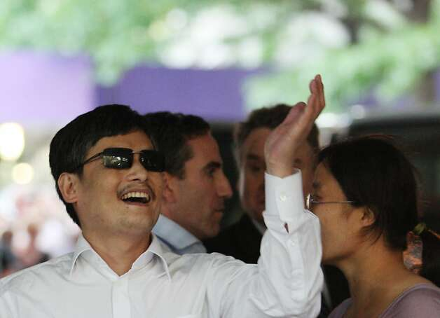 NEW YORK - MAY 19:  Blind Chinese activist Chen Guangcheng gesters before making remarks to the media upon arriving on the campus of New York University on May 19, 2012 in New York City. China allowed the activist to leave a hospital in Beijing and board a plane for the U.S., a move that could signal the end of a diplomatic standoff between the two countries. (Photo by Andy Jacobsohn/Getty Images) Photo: Andy Jacobsohn, Getty Images