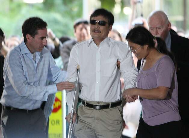 NEW YORK - MAY 19:  Blind Chinese activist Chen Guangcheng steps out of a van with his wife, Yuan Weijing, beside him before making remarks to the media upon arriving on the campus of New York University on May 19, 2012 in New York City. China allowed the activist to leave a hospital in Beijing and board a plane for the U.S., a move that could signal the end of a diplomatic standoff between the two countries. (Photo by Andy Jacobsohn/Getty Images) Photo: Andy Jacobsohn, Getty Images