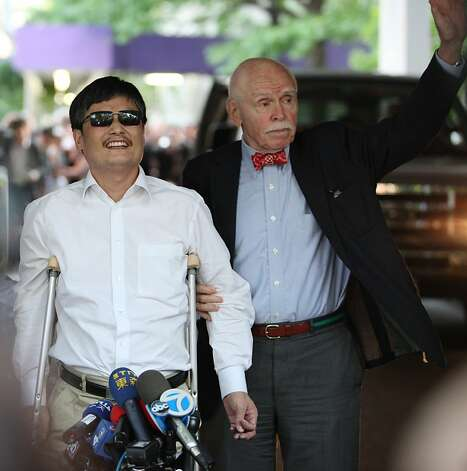 NEW YORK - MAY 19:  Blind Chinese activist Chen Guangcheng makes remarks to the media, while standing beside NYU professor Jemore Cohen, upon arriving on the campus of New York University on May 19, 2012 in New York City. China allowed the activist to leave a hospital in Beijing and board a plane for the U.S., a move that could signal the end of a diplomatic standoff between the two countries. (Photo by Andy Jacobsohn/Getty Images) Photo: Andy Jacobsohn, Getty Images