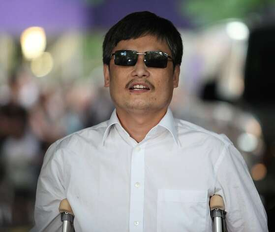NEW YORK - MAY 19:  Chinese activist Chen Guangcheng makes remarks to the media upon arriving on the campus of New York University on May 19, 2012 in New York City. China allowed the activist to leave a hospital in Beijing and board a plane for the U.S., a move that could signal the end of a diplomatic standoff between the two countries. (Photo by Andy Jacobsohn/Getty Images) Photo: Andy Jacobsohn, Getty Images