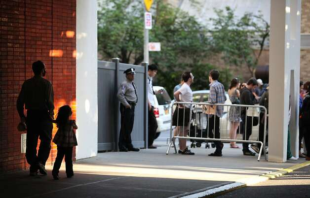 NEW YORK - MAY 19:  Viewers gather to secure a space before Chinese activist Chen Guangcheng made remarks to the media upon arriving on the campus of New York University on May 19, 2012 in New York City. China allowed the activist to leave a hospital in Beijing and board a plane for the U.S., a move that could signal the end of a diplomatic standoff between the two countries. (Photo by Andy Jacobsohn/Getty Images) Photo: Andy Jacobsohn, Getty Images