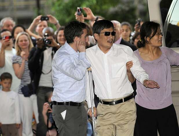 Blind Chinese legal activist Chen Guangcheng arrives at the campus of New York University, Saturday, May 19, 2012 in New York.  Chen escaped from his village in April and was given sanctuary inside the U.S. Embassy after seven years of prison and house arrest. He is planning to study law at NYU. But before that, he says he is planning to spend time recuperating. (AP Photo/ Louis Lanzano) Photo: Louis Lanzano, Associated Press