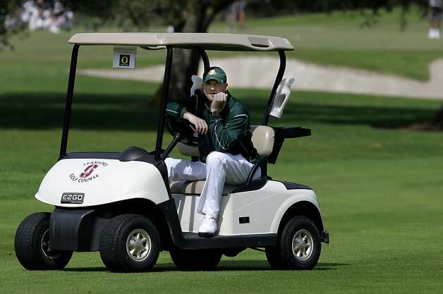 Oregon Ducks golf coach Casey Martin watches from his cart as he works with his team during a practice around at the Stanford Golf Course, on Thursday March 29, 2012, in Palo Alto, Ca.  Casey Martin's brightest moment on the PGA tour might have been the 1998 US Open at the Olympic Club, in San Francisco, where he tied for 23rd while riding in a golf cart amid widespread controversy. Photo: Michael Macor, The Chronicle