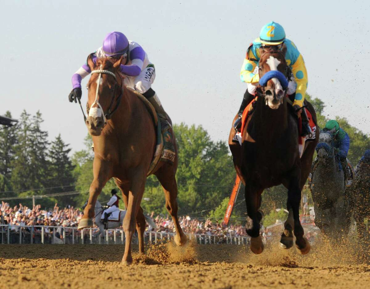 I'll Have Another, left ridden by Mario Gutierrez in the irons beats Bodemeister with Mike Smith in the irons to the wine the 137th running of The Preakness Stakes at Pimlico in Baltimore, MD. May 19, 2012. (Skip Dickstein / Times Union)
