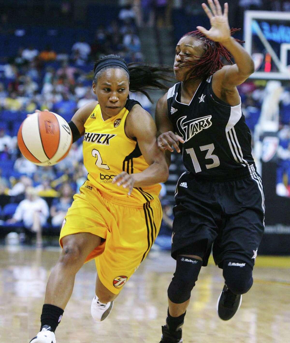Tulsa Shock's Temeka Johnson tries to get around San Antonio Silver Stars' Danielle Robinson during a WNBA basketball game Saturday, May 19, 2012, in Tulsa, Okla. (AP Photo/Tulsa World, James Gibbard) ONLINE OUT TV OUT TULSA OUT