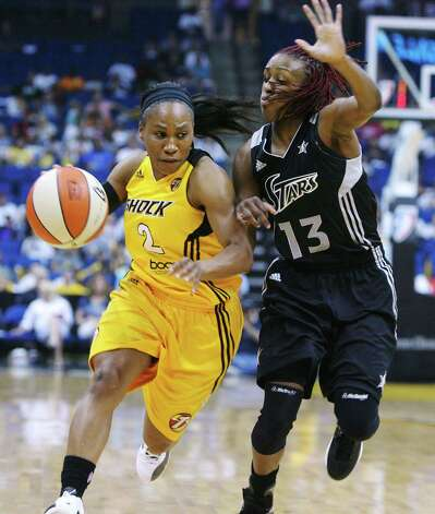 Tulsa Shock's Temeka Johnson tries to get around San Antonio Silver Stars' Danielle Robinson during a WNBA basketball game Saturday, May 19, 2012, in Tulsa, Okla. (AP Photo/Tulsa World, James Gibbard) ONLINE OUT  TV OUT  TULSA OUT Photo: Associated Press