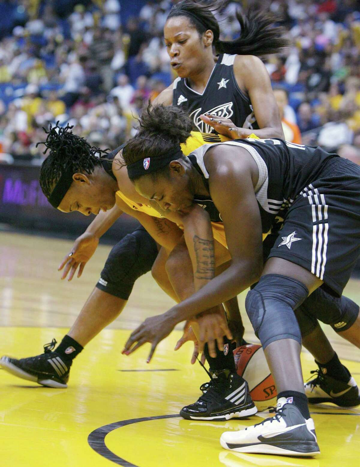 Tulsa Shock's Riquna Williams and San Antonio Silver Stars' Sophia Young, front, scramble for the ball during a WNBA basketball game Saturday, May 19, 2012, in Tulsa, Okla. (AP Photo/Tulsa World, James Gibbard) ONLINE OUT TV OUT TULSA OUT