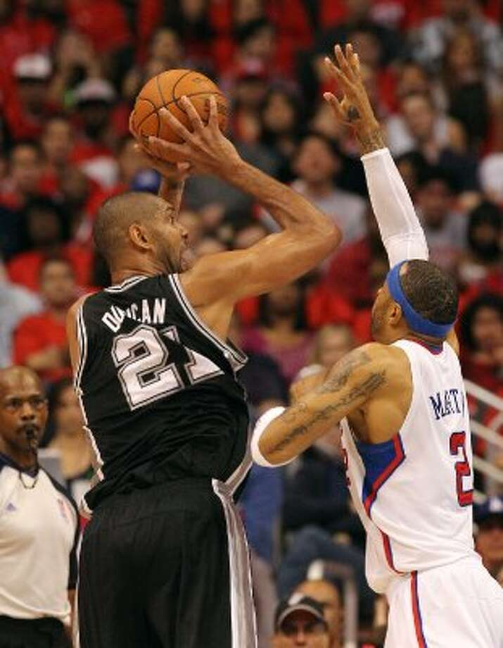 Spurs' Tim Duncan (21) takes a shot over the Los Angeles Clippers' Kenyon Martin (02) in the second half of game three of the Western Conference semifinals at the Staples Center in Los Angeles on Saturday, May 19, 2012. The Spurs won 96-86.  Kin Man Hui/Express-News (SAN ANTONIO EXPRESS-NEWS)