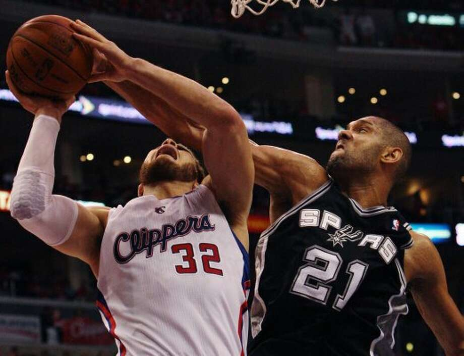 Spurs' Tim Duncan (21) blocks a shot against the Los Angeles Clippers' Blake Griffin (32) in the second half of game three of the Western Conference semifinals at the Staples Center in Los Angeles on Saturday, May 19, 2012. The Spurs won 96-86.  Kin Man Hui/Express-News (SAN ANTONIO EXPRESS-NEWS)