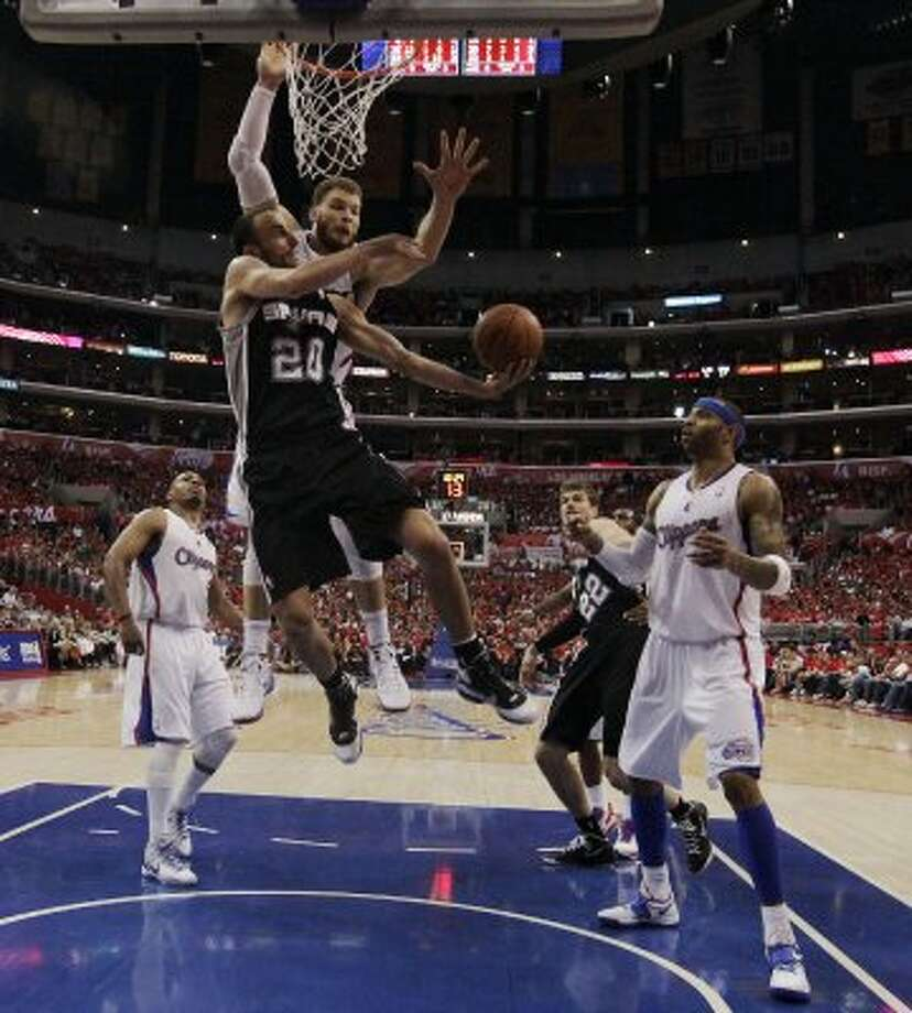 Spurs' Manu Ginobili (20) goes for a shot under the basket against the Los Angeles Clippers' Blake Griffin (32) in the second half of game three of the Western Conference semifinals at the Staples Center in Los Angeles on Saturday, May 19, 2012. The Spurs won 96-86.  Kin Man Hui/Express-News (SAN ANTONIO EXPRESS-NEWS)