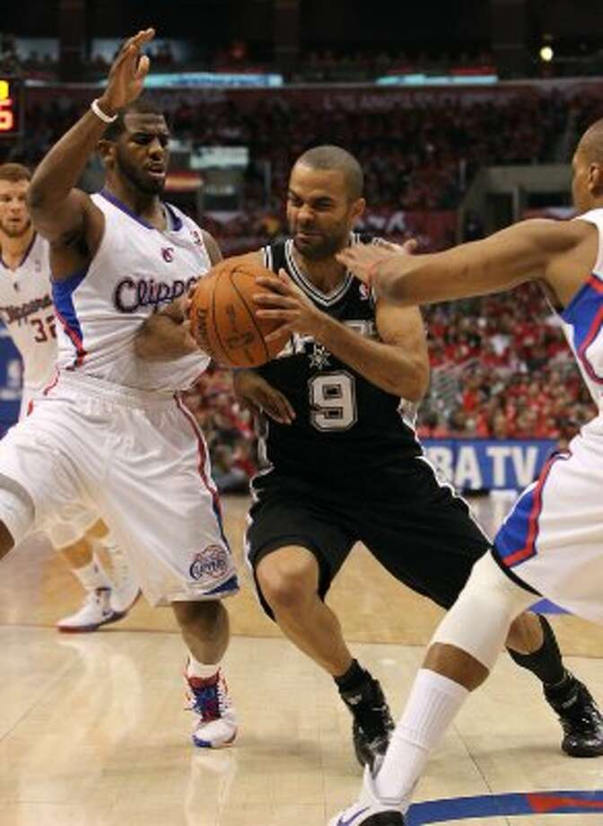 Spurs' Tony Parker (09) drives the basket against the Los Angeles Clippers' Chris Paul (03) in the first half of game three of the Western Conference semifinals at the Staples Center in Los Angeles on Saturday, May 19, 2012. The Spurs won 96-86.  Kin Man Hui/Express-News (SAN ANTONIO EXPRESS-NEWS)