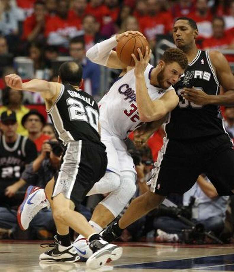 Los Angeles Clippers' Blake Griffin (32) attempts to maneuver around Manu Ginobili (20) and Boris Diaw (33) in the first half of game three of the Western Conference semifinals at the Staples Center in Los Angeles on Saturday, May 19, 2012. The Spurs won 96-86.  Kin Man Hui/Express-News (SAN ANTONIO EXPRESS-NEWS)