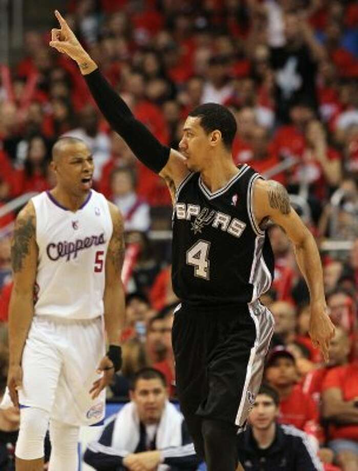 Spurs' Danny Green (04) gestures as the Los Angeles Clippers' Caron Butler (05) reacts to Green's shot in the second half of game three of the Western Conference semifinals at the Staples Center in Los Angeles on Saturday, May 19, 2012. The Spurs won 96-86.  Kin Man Hui/Express-News (SAN ANTONIO EXPRESS-NEWS)