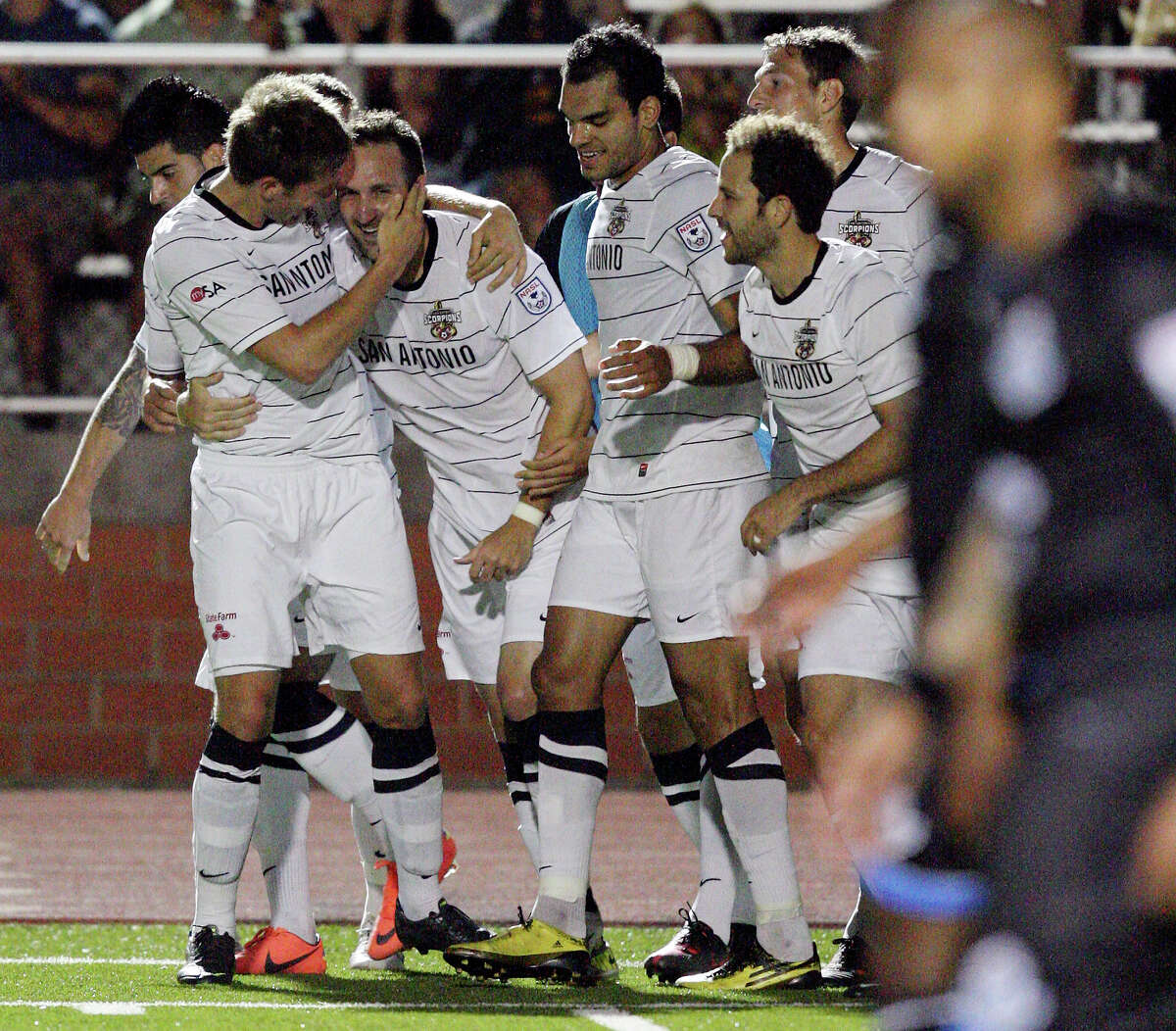 Scorpions' Fabian Kling (left) celebrates with teammate Ryan Cochrane after Cochrane scored a goal against FC Edmonton during second half action Saturday May 19, 2012 at Heroes Stadium. The Scorpions won 2-0.