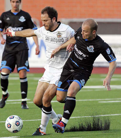 Scorpions' Kevin Harmse and FC Edmonton's Ilja Van Leerdam struggle for control of the ball during first half action Saturday May 19, 2012 at Heroes Stadium. Photo: EDWARD A. ORNELAS, SAN ANTONIO EXPRESS-NEWS / © SAN ANTONIO EXPRESS-NEWS (NFS)