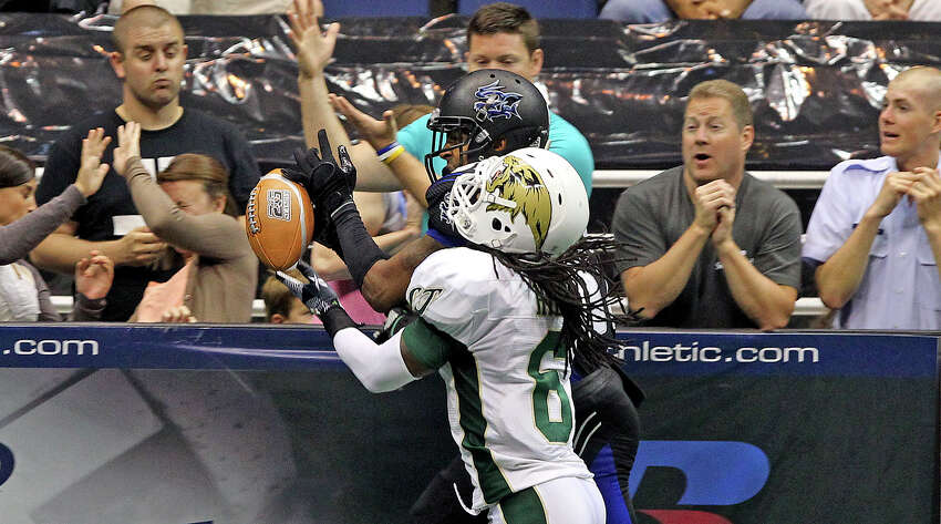 Talons receiver Burl Toler can't control a pass on the sideline defended by Vince Hill as the San antonio Talons play the San Jose Sabercats on May 19, 2012. Tom Reel/ San Antonio Express-News