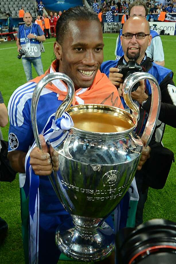 Chelsea's Ivorian forward Didier Drogba  holds the trophy after the UEFA Champions League final football match between FC Bayern Muenchen and Chelsea FC on May 19, 2012 at the Fussball Arena stadium in Munich.  Chelsea won 4-3 in the penalty phase.  AFP PHOTO / ADRIAN DENNISADRIAN DENNIS/AFP/GettyImages Photo: Adrian Dennis, AFP/Getty Images