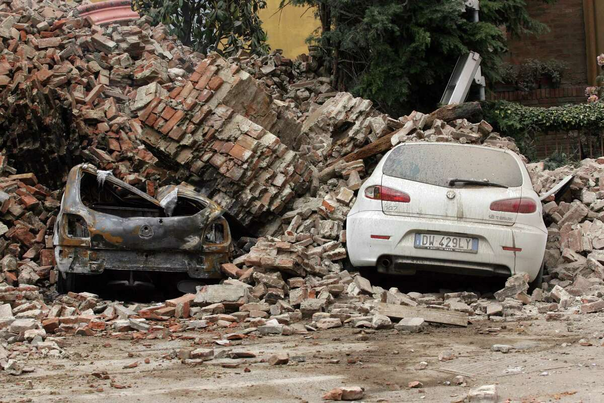 Cars are damaged following an earthquake on May 20, 2012 in Finale Emila. A powerful earthquake shook Italy's industrial and densely populated northeast early Sunday, killing three people and felling homes and church steeples around the historic city of Ferrara. AFP PHOTO / PIERRE TEYSSOTPIERRE TEYSSOT/AFP/GettyImages