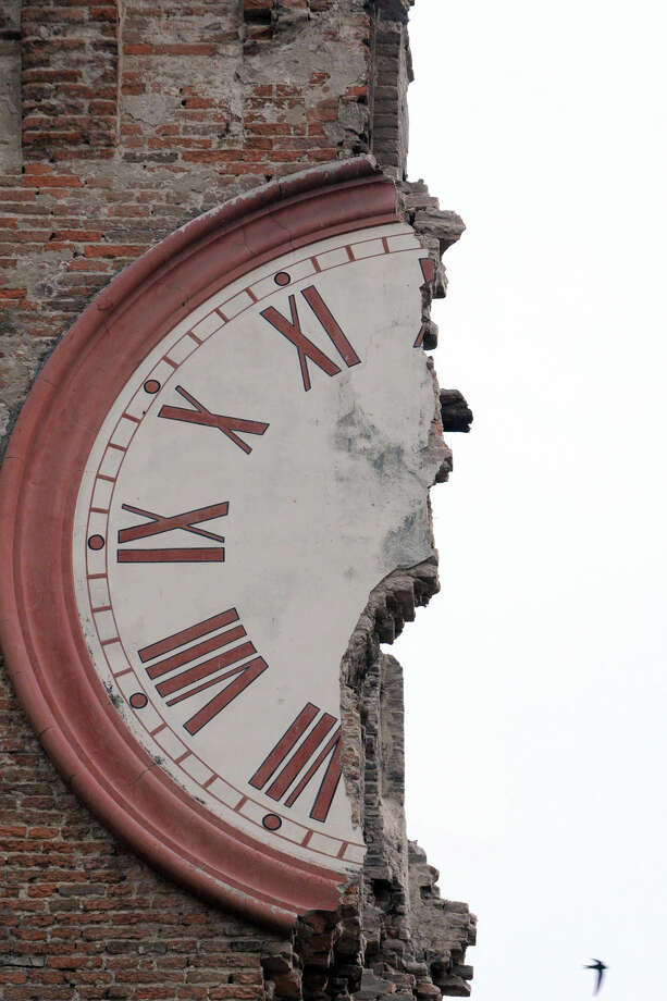 The damaged clock tower of Finale Emilia, Italy, Sunday, May 20, 2012. A magnitude 6 earthquake shook northern Italy early Sunday, killing at least four people. The quake struck at 4:04 a.m. Sunday between Modena and Mantova, about 35 kilometers (22 miles) north of Bologna at a relatively shallow depth of 10 kilometers (6 miles), the U.S. Geological Survey said. Photo: Gianfilippo Oggioni, AP / PRESL