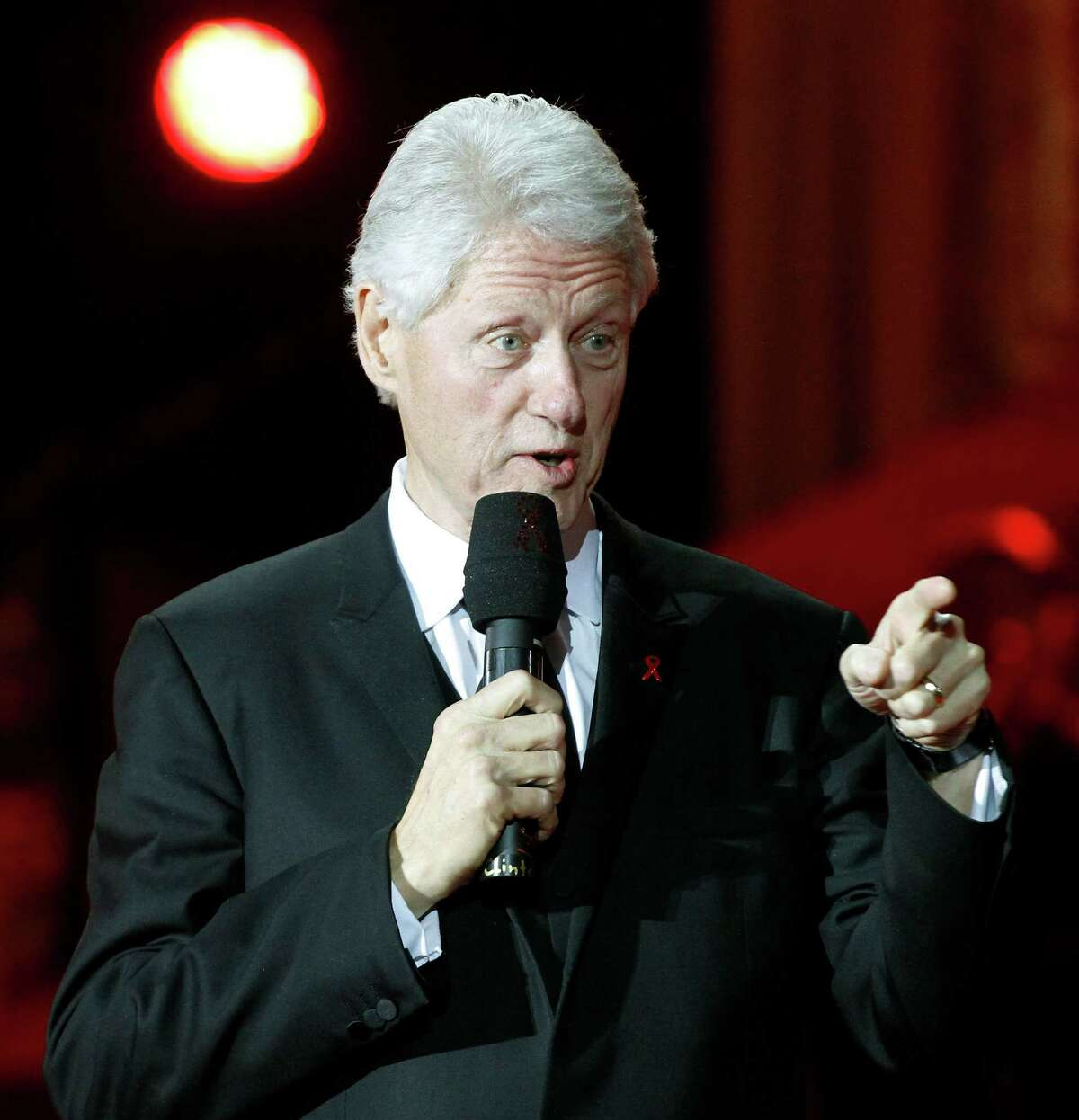 Former U.S. President Bill Clinton delivers a speech during the opening ceremony of the 20th Life Ball in front of the city hall in Vienna, Austria, on Saturday, May 19, 2012. The Life Ball is a charity gala to raise money for people living with HIV and AIDS.