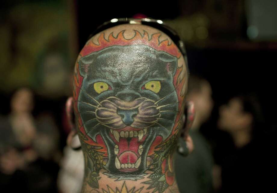 A tattooed panther is seen on the back of the head of a man during the 15th Annual Tattooing Convention in Manhattan in New York, May 19, 2012. AFP PHOTO / MLADEN ANTONOVMLADEN ANTONOV/AFP/GettyImages Photo: MLADEN ANTONOV, AFP/Getty Images / AFP