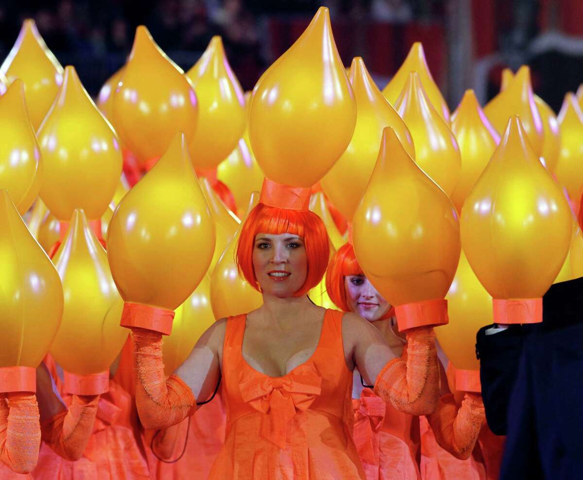 Models perform on the catwalk during the opening ceremony of the 20th Life Ball in front of the city hall in Vienna, Austria, on Saturday, May 19, 2012. The Life Ball is a charity gala to raise money for people living with HIV and AIDS.