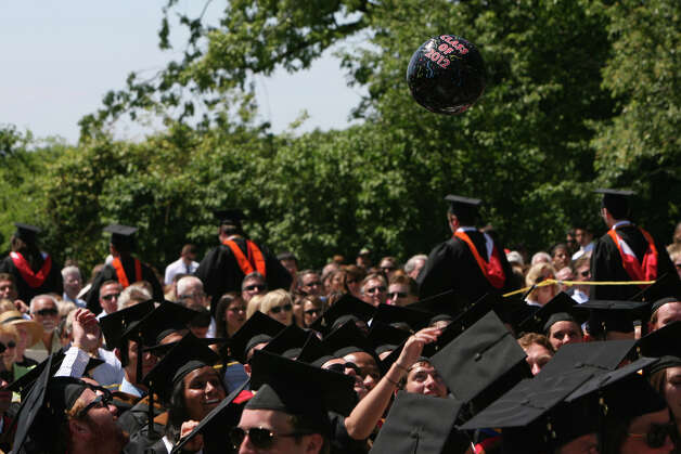 Fairfield University graduates throw a ball into the air during the university's 62nd commencement exercises in Fairfield, Conn. on Sunday, May 20, 2012. Photo: B.K. Angeletti / Connecticut Post