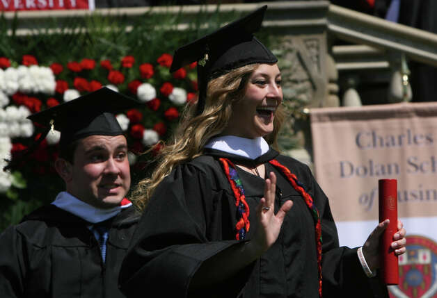 Victoria Cloughter, of MA, waves after receiving her diploma at Fairfield University's 62nd commencement exercises in Fairfield, Conn. on Sunday, May 20, 2012. Photo: B.K. Angeletti / Connecticut Post
