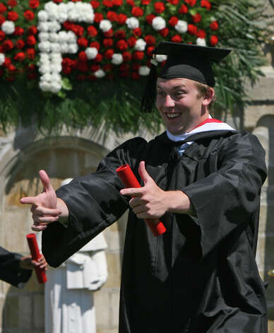 Douglas Freeman of NJ, reacts after receiving his diploma at Fairfield University's 62nd commencement exercises in Fairfield, Conn. on Sunday, May 20, 2012. Photo: B.K. Angeletti / Connecticut Post