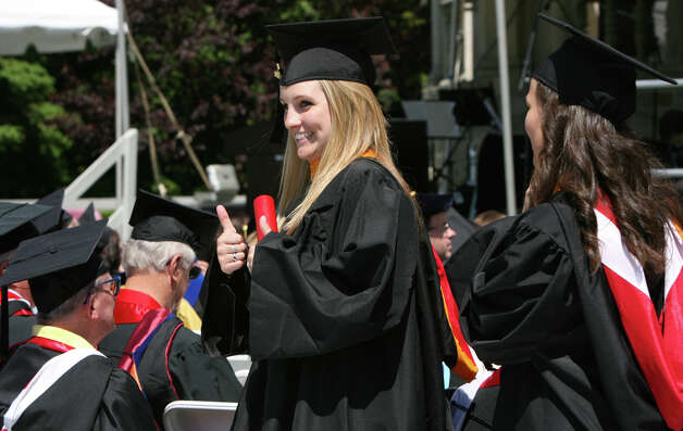 Kim Burke, of ME, reacts after receiving her diploma at Fairfield University's 62nd commencement exercises in Fairfield, Conn. on Sunday, May 20, 2012. Photo: B.K. Angeletti / Connecticut Post