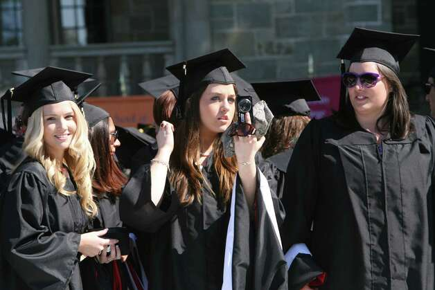 Rebecca Flynn looks in her camera during Fairfield University's 62nd commencement exercises in Fairfield, Conn. on May 20, 2012. Photo: B.K. Angeletti / Connecticut Post