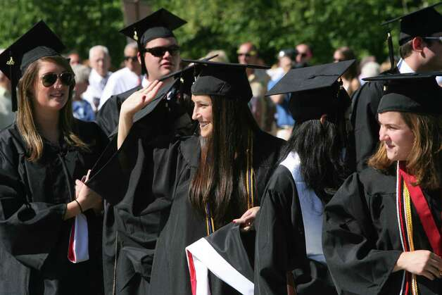 Corie Hutter, of MA, waves to family during Fairfield University's 62nd commencement exercises in Fairfield, Conn. on Sunday, May 20, 2012. Photo: B.K. Angeletti / Connecticut Post