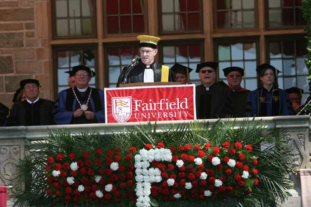 The Reverend Paul Fitzgerald gives the introduction at Fairfield University's 62nd commencement exercises in Fairfield, Conn. on May 20, 2012. Photo: B.K. Angeletti / Connecticut Post