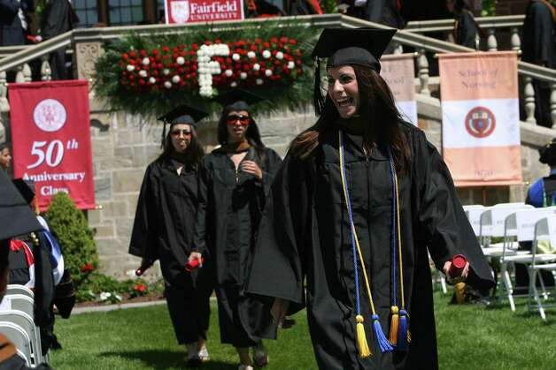 Mary Hamann, of Orange, reacts after receiving her diploma at Fairfield University's 62nd commencement exercises in Fairfield, Conn. on Sunday, May 20, 2012. Photo: B.K. Angeletti / Connecticut Post