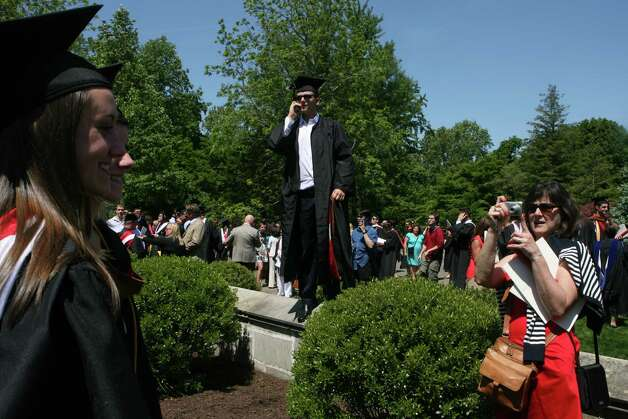 Graduate George Daniolos, of Shelton, searches for family after Fairfield University's 62nd commencement exercises in Fairfield, Conn. on May 20, 2012. Photo: B.K. Angeletti / Connecticut Post