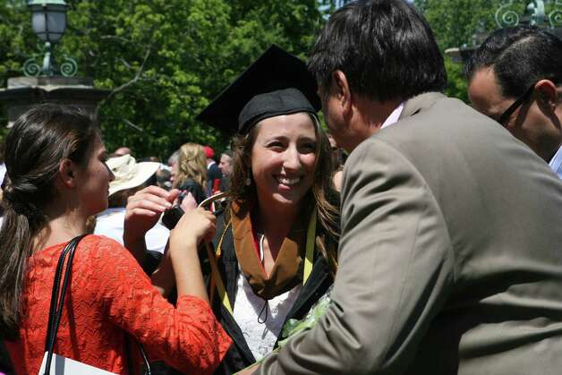 Graduate Amelia Mazzola, of MA, is greeted by family after Fairfield University's 62nd commencement exercises in Fairfield, Conn. on May 20, 2012. Photo: B.K. Angeletti / Connecticut Post