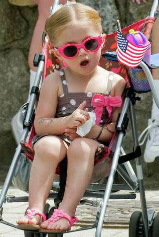 Two-year-old Shea Wilson of Danbury sees the Bethel Memorial Day parade approaching on Greenwood Avenue. Sunday, May 20, 2012 Photo: Scott Mullin / The News-Times Freelance