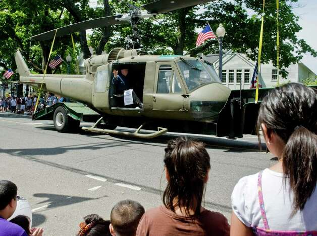 A Korean War Veterans helicopter makes it's way up Greenwood Avenue during the Bethel Memorial Day parade. Sunday, May 20, 2012 Photo: Scott Mullin / The News-Times Freelance