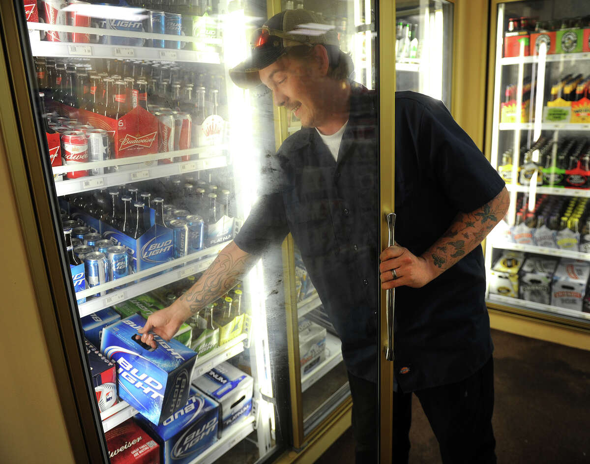 Rick Dionne of Stratford picks out some beer at Super Saver Spirits on Bridgeport Avenue in Shelton on Sunday, May 20, 2012, the first day of Sunday liquor sales in the state of Connecticut.