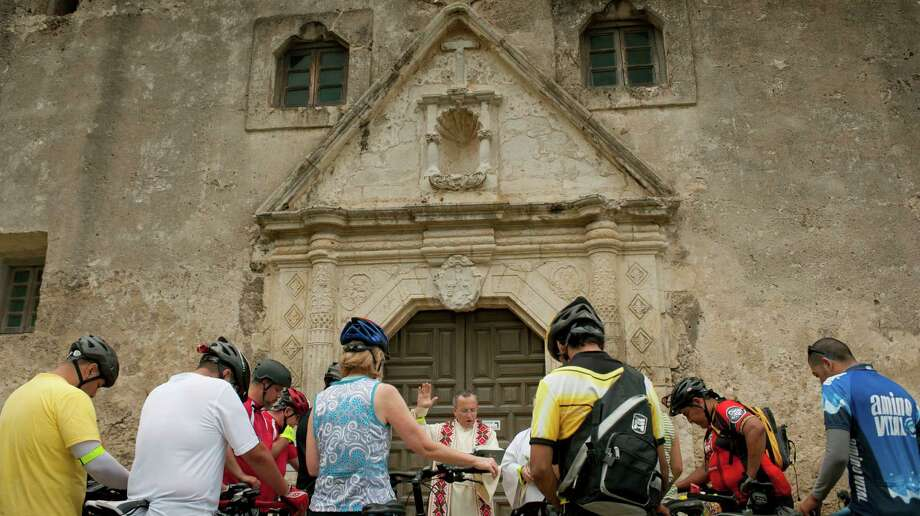 Father David Garcia blesses bicycles and riders, Sunday, May 20, 2012, at Mission Concepcion in San Antonio. Photo: Darren Abate, Darren Abate/Special To The Express-News